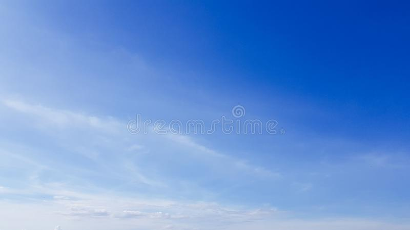 Clear blue sky with white cloud background. Clearing day and Good weather in the morning.  royalty free stock image