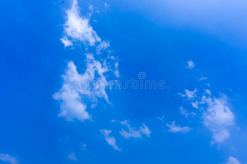 Clear blue sky with white cloud background in the morning. Good weather background stock photo