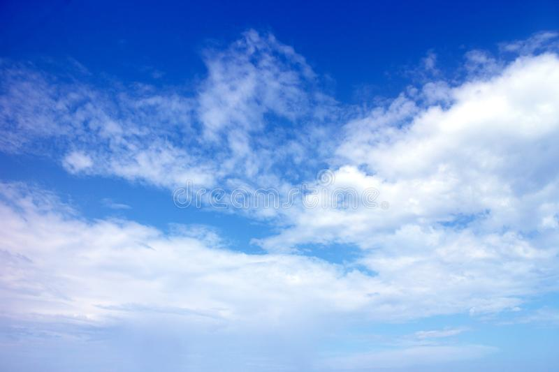 Clear blue sky and white clouds background, cloudy daytime cyan cosmos banner, cloudless climate wallpaper. Bright open air atmosphere backdrop stock photography