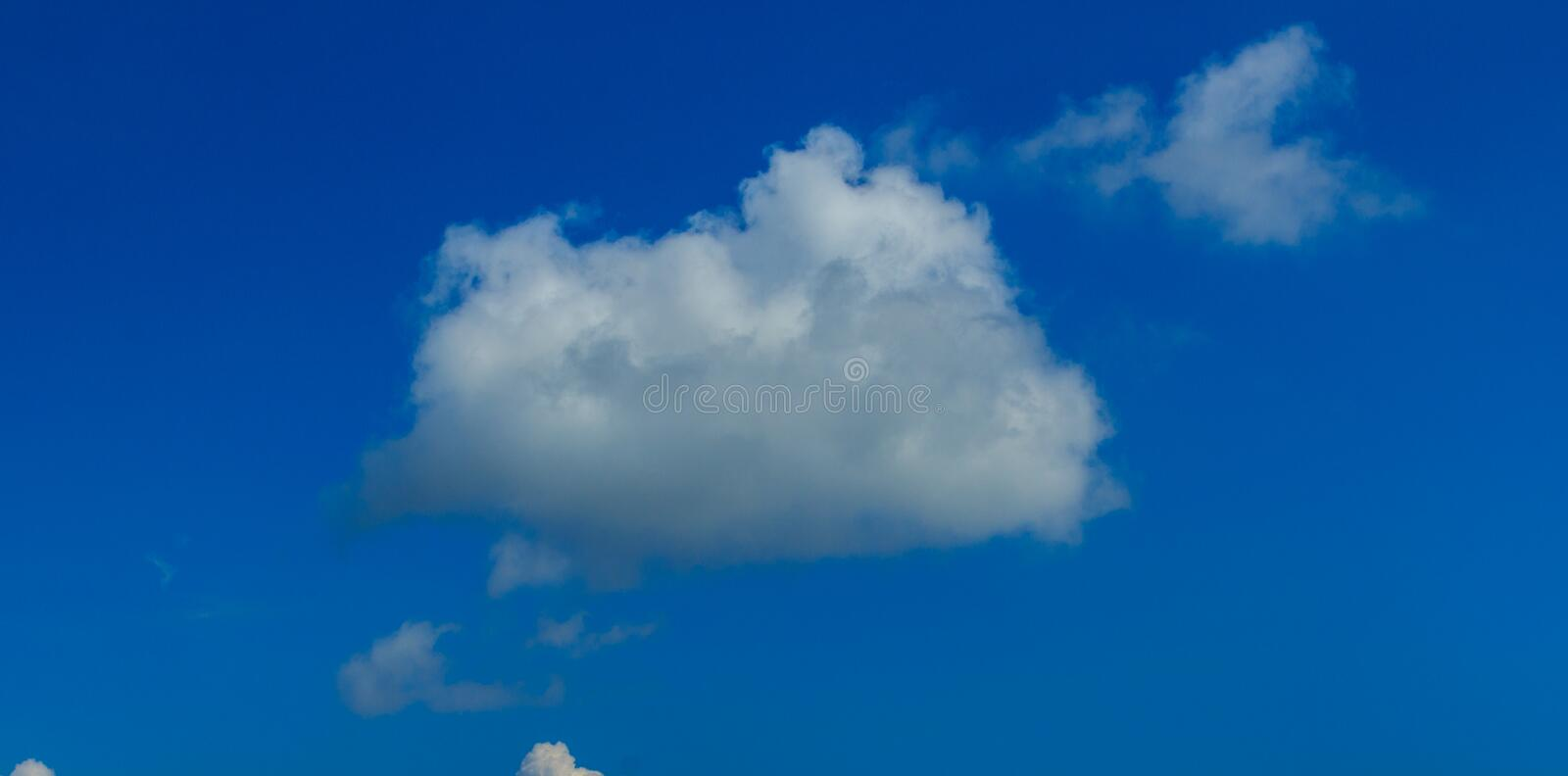 Clear blue sky with white clouds. Cloudless sky. Blue sky with a. Cloud obscured the view daytime desolate empty air clean royalty free stock photos