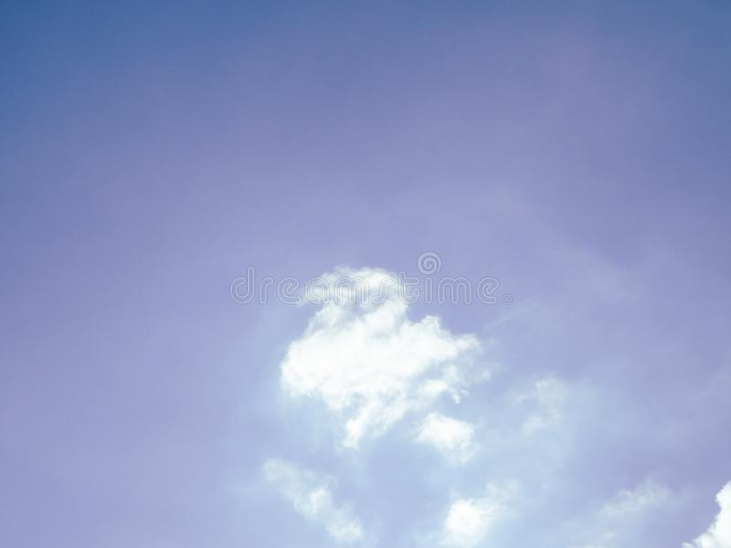 Clear blue sky and white clouds summer background stock image