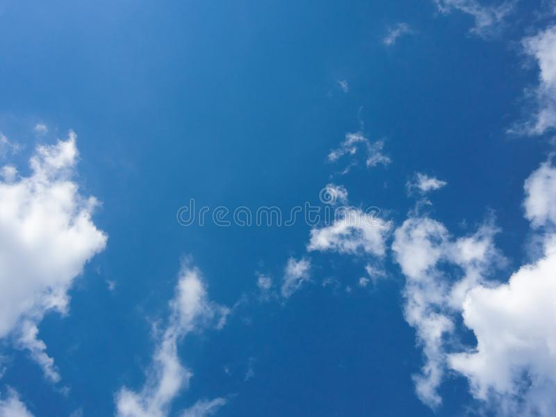 Clear blue sky and white clouds summer background stock images