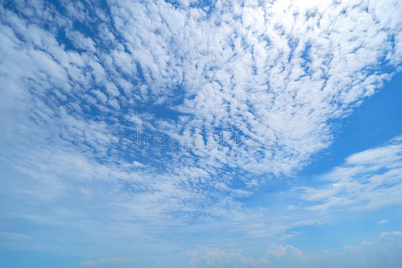 Clear blue sky with white fluffy clouds. Nature background.  stock image