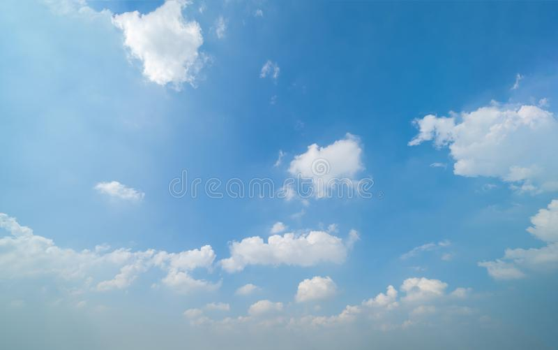 Clear blue sky with white fluffy clouds in summer season at noon time. Abstract nature background stock photos