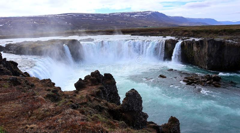 Clear blue water falling down from Godafoss waterfall royalty free stock images