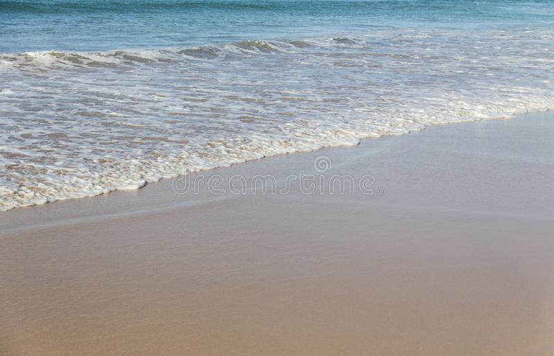 Waves in Manly Beach, Australia. The clear blue waves meet the orange sand of Manly Beach in Sydney, Australia stock image