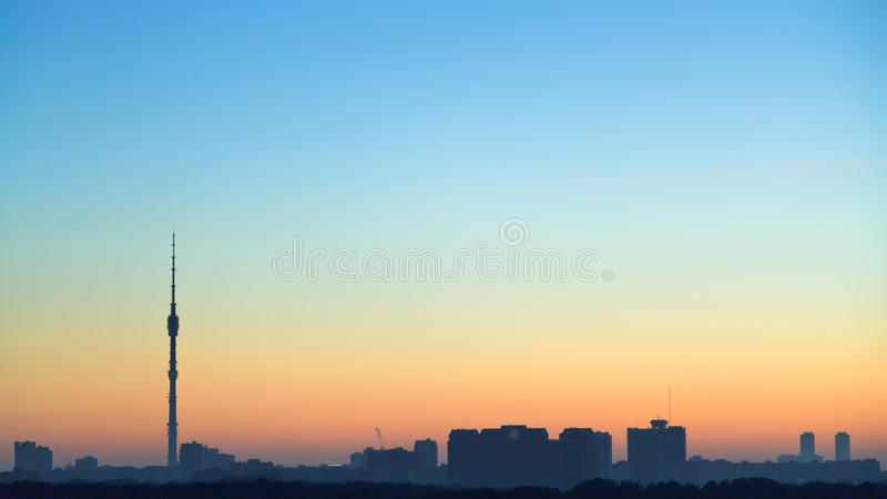 Clear blue and yellow dawning sky over city. Moscow royalty free stock photo