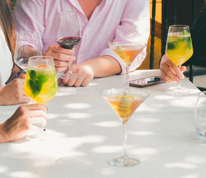 Clear Cocktail Glass on Top of White Wooden Table stock image