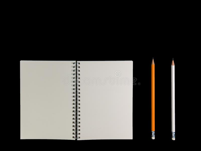 Clear color note book opened for note or lecture note or memo for remine and brown cover whit black head color pencil in white ap royalty free stock images