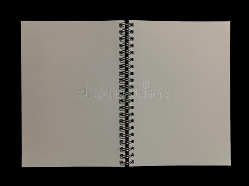 Clear color note book opened for note or lecture note or memo for remine on black background. stock image