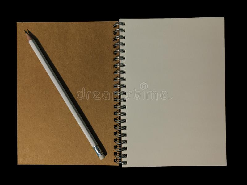 Clear color note book opened for note or lecture note or memo for remine and brown cover with black head color pencil in white ap. Clear color note book opened stock photo