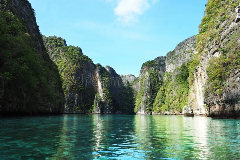 Clear crystal green sea high mountain cliffs phi phi island Thailand. Travel, asia, tropical, holiday, swim, diving, scuba royalty free stock images