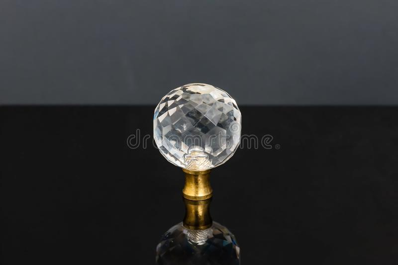 Clear cut glass sphere that was most likely a drawer knob previously. A clear cut glass sphere that was most likely a drawer knob previously royalty free stock photography