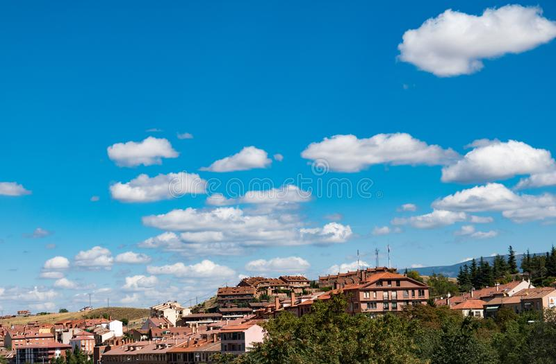 Clear distinct clouds. Clear sky with distinct clouds on a town backdrop royalty free stock image