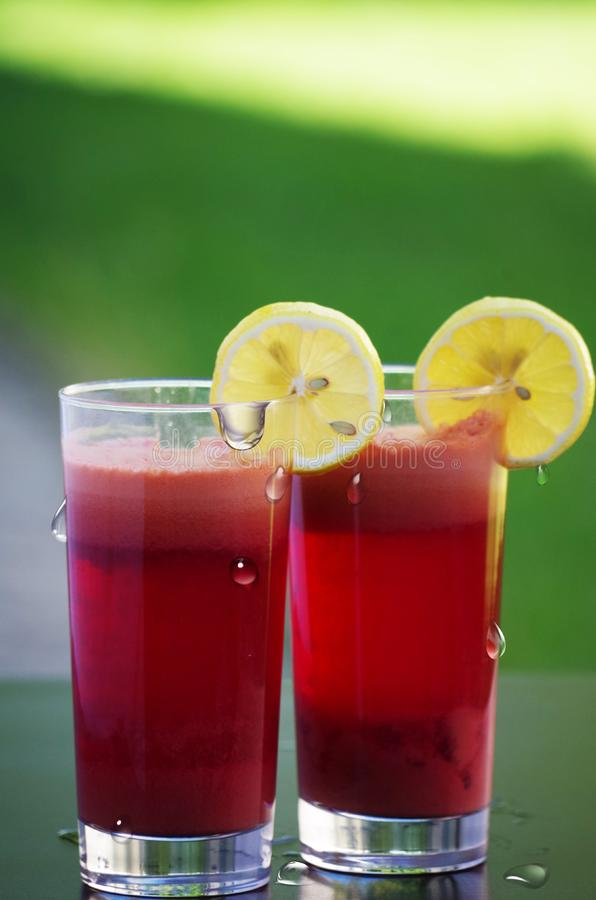 Clear Drinking Glass Filled With Red Liquid With Sliced Lemon stock images