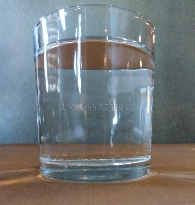 Clear drinking water filled in glass kept on table stock photo