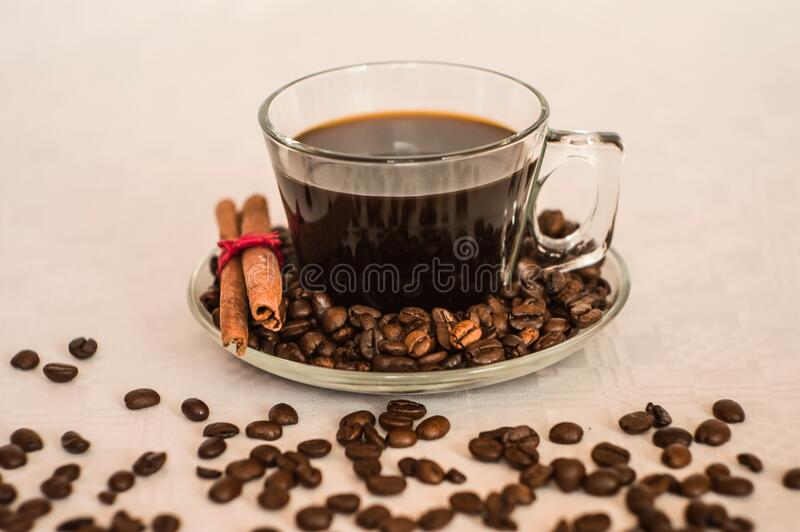 Clear Glass Coffee Cup on Clear Round Glass Saucer stock image