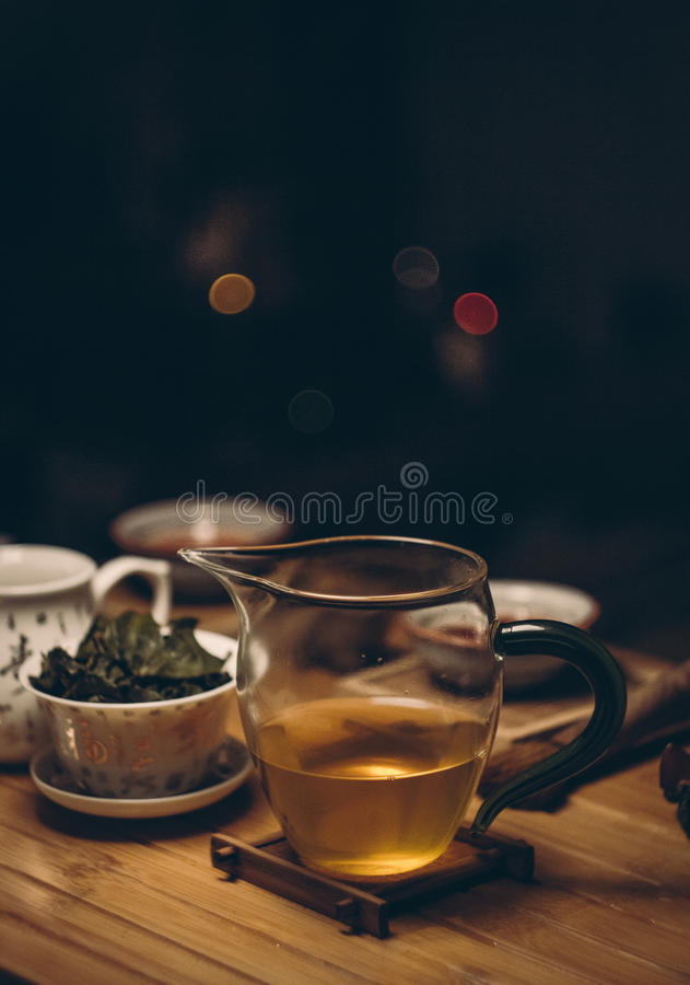 Clear Glass Cup on Brown Wooden Table stock images