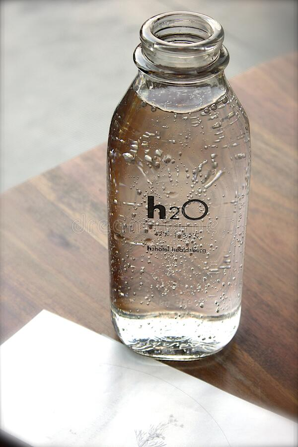 Clear Glass H2o Bottle royalty free stock photo