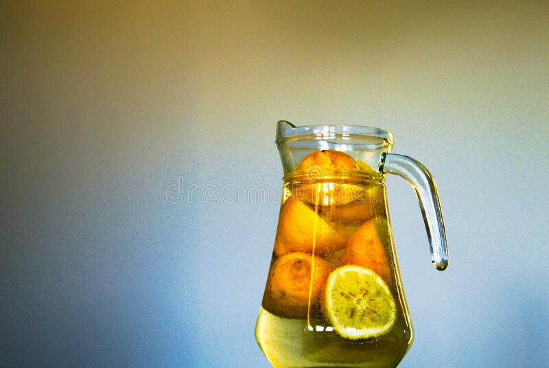 Clear Glass Pitcher With Sliced Yellow Round Fruit Inside Free Public Domain Cc0 Image
