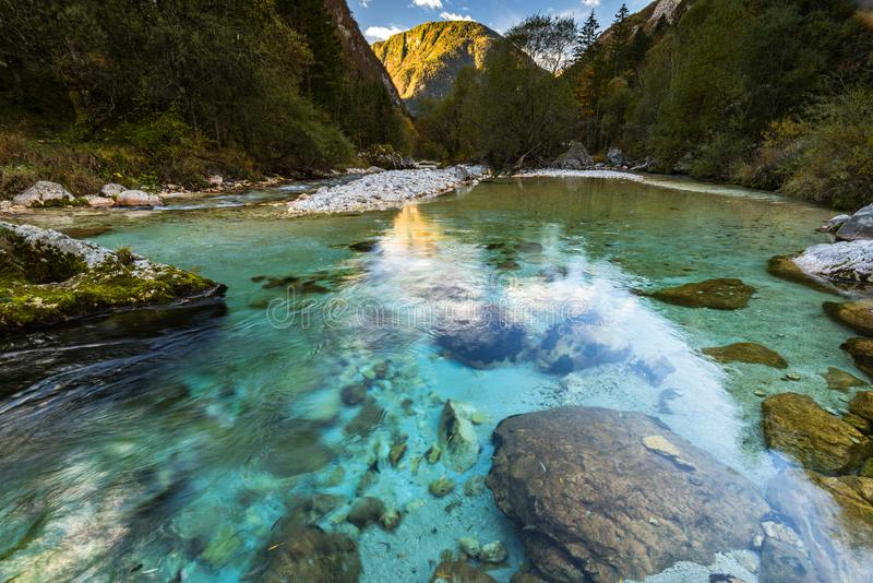 Clear green turquoise water of Soca river in Slovenia stock photo