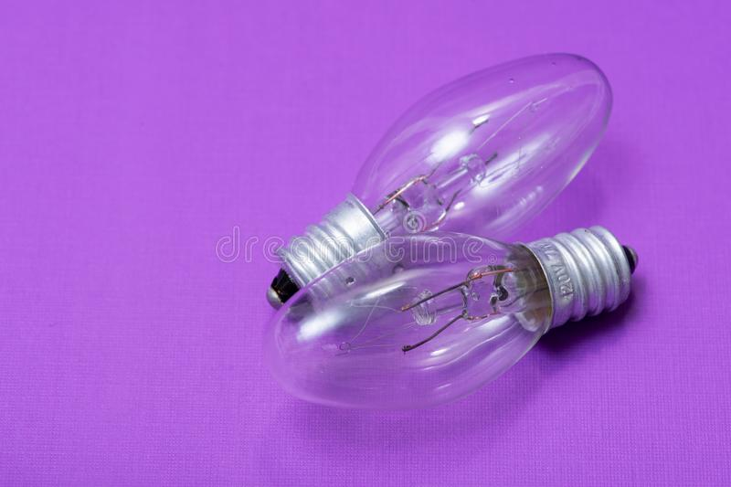 Clear Incandescent Night Light Bulbs with candelabra base on purple royalty free stock image