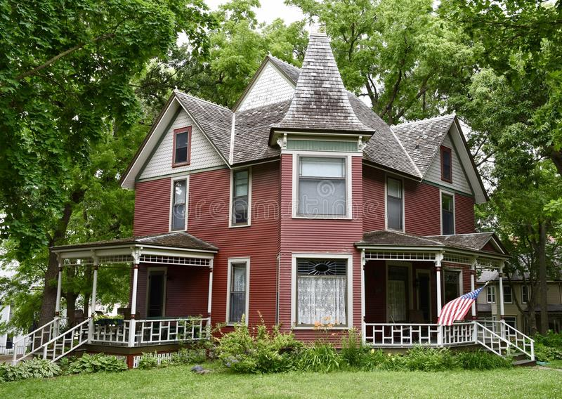 Clear Lake Italianate. This is a Summer picture of a wood framed house located in Clear Lake, Iowa in Cerritos County. This example of Italianate architecture royalty free stock photography