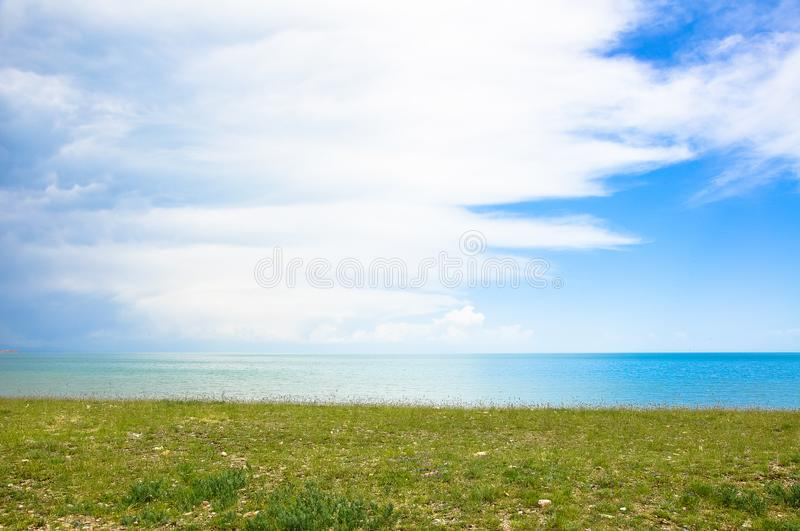Clear lake water and blue sky. Clear lake water with blue sky and pasture royalty free stock images