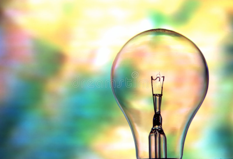 Clear Light Bulb. A clear light bulb with scrambled television in the background stock images