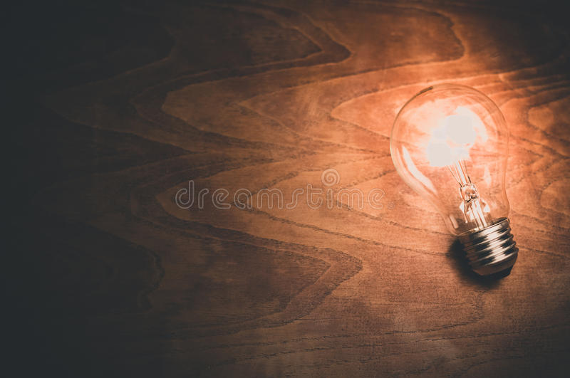 Clear Light Bulb Lighted On Brown Wood Free Public Domain Cc0 Image