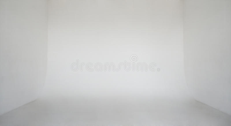 Clear light white wall empty photo studio. Cyclorama background royalty free stock image