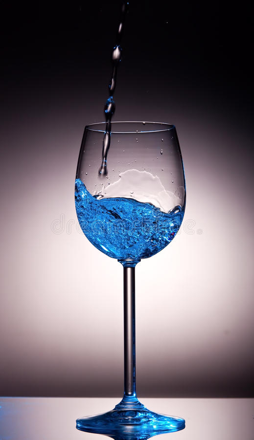 Download Clear Liquid Poured Into Crystal Wine Glass Stock Photo - Image: 25767194