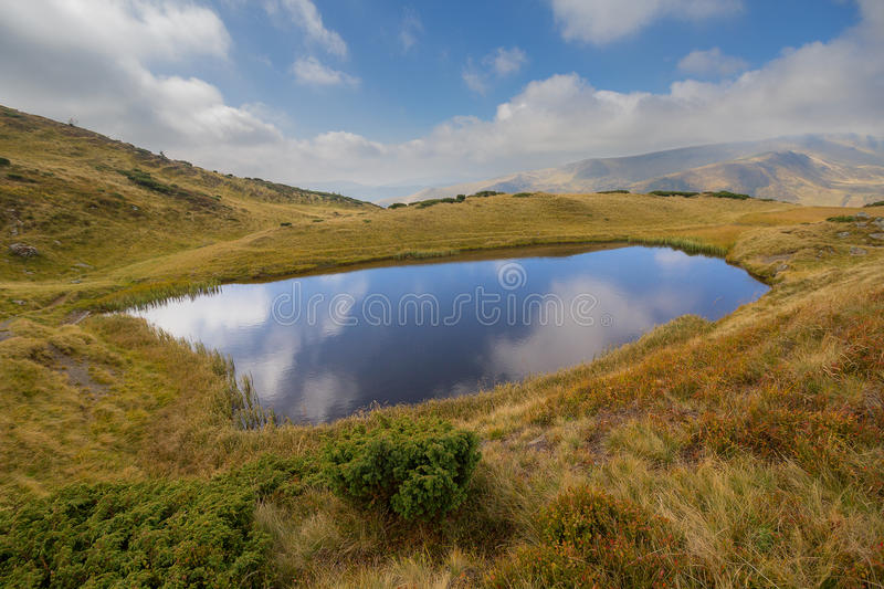 Clear lke, clouds and Svydovets ridge. Carpathians royalty free stock photography