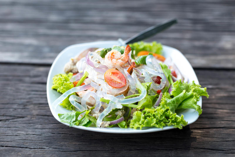 Clear noodle salad with prawn and vegetable royalty free stock image