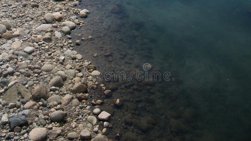 Clear Pristine river near a rocky river bed royalty free stock photography