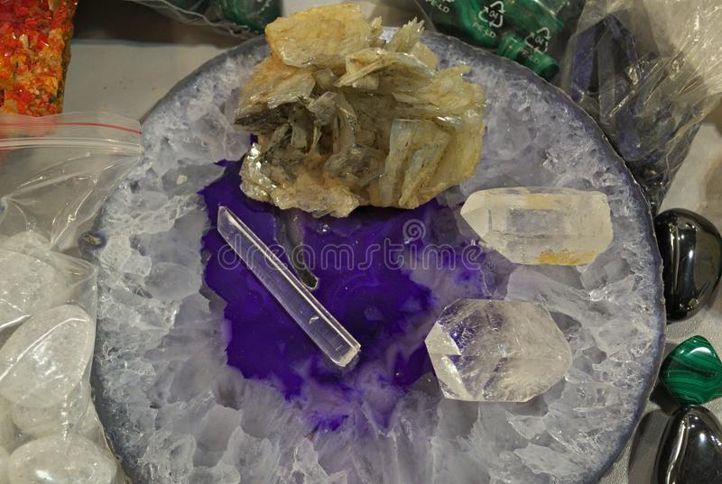 Clear quartz natural healing crystals displayed on table royalty free stock photo
