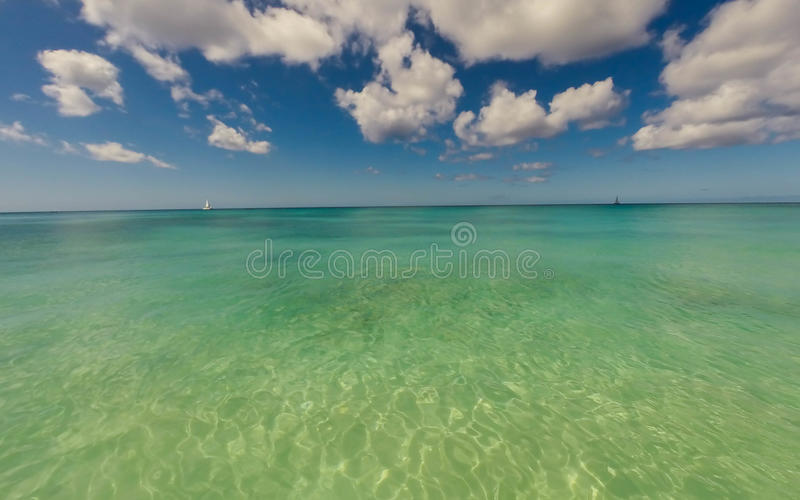 Clear sea in a Caribbean island. Clear sea with sail boats in Barbados stock photos