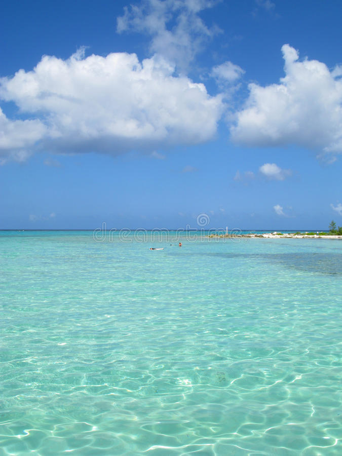 Clear Sea and Fluffy Clouds stock photography