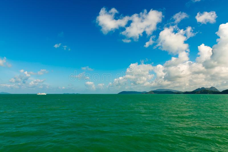 Download Seascape With White Sea Ferry And Green Islands On Horizon Stock Photo - Image of scenic, seascape: 106387380