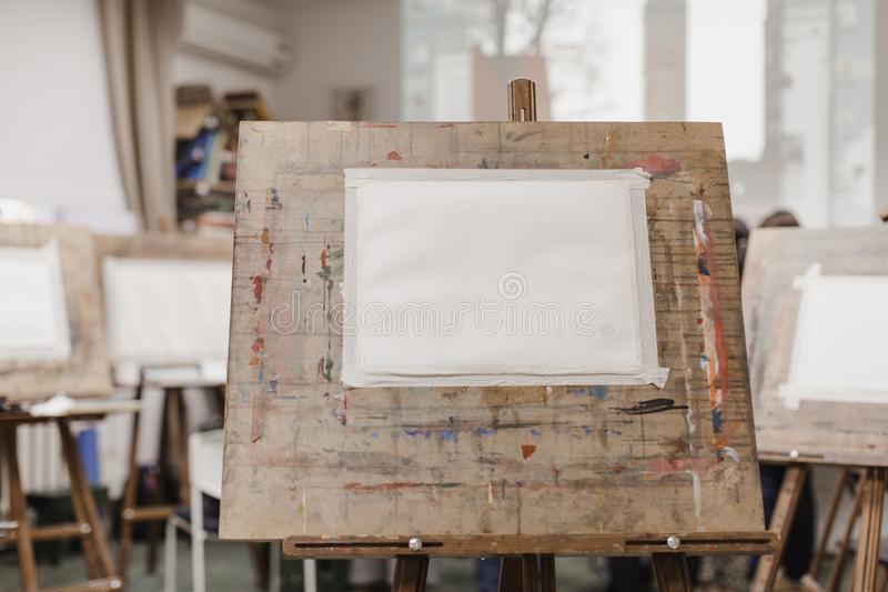 Sheet of paper on easel. Clear sheet of paper on easel in drawing class stock photo
