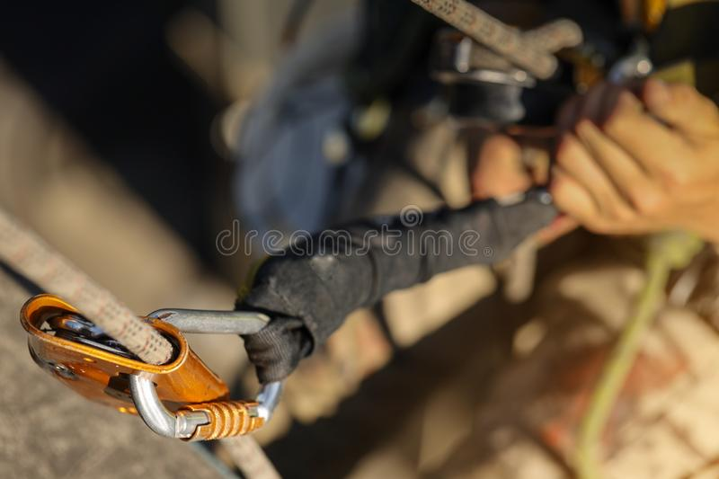 Clear shoot of industrial rope access abseiler using fall arrester backup device. Clear shoot industrial rope access fall arrester backup device its moves freely royalty free stock photo
