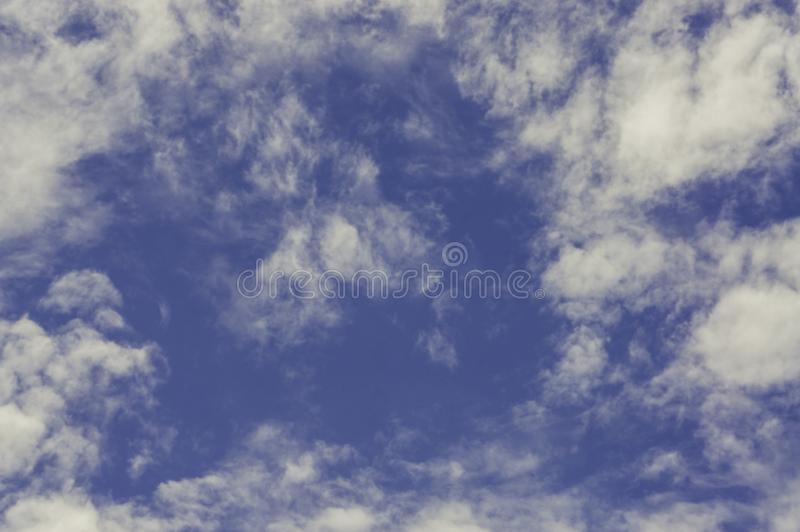 Clear sky on a fine day. With light sun With pattern of clouds form a beautiful nature. Feel relaxed and independent. stock image