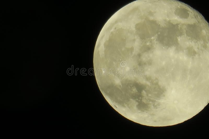 Clear sky and fullmoon at night. Clear sky and close up fullmoon at night stock photo