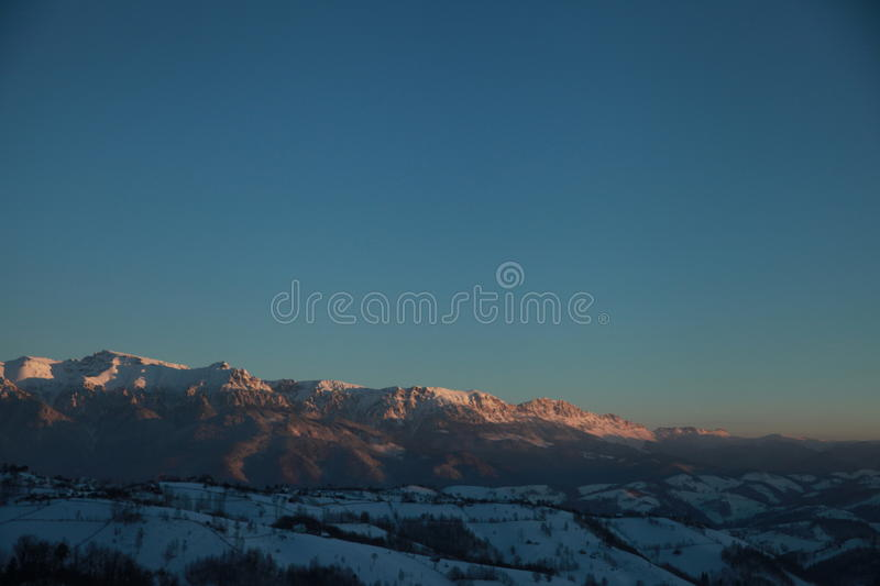 Clear sky over the mountains stock image
