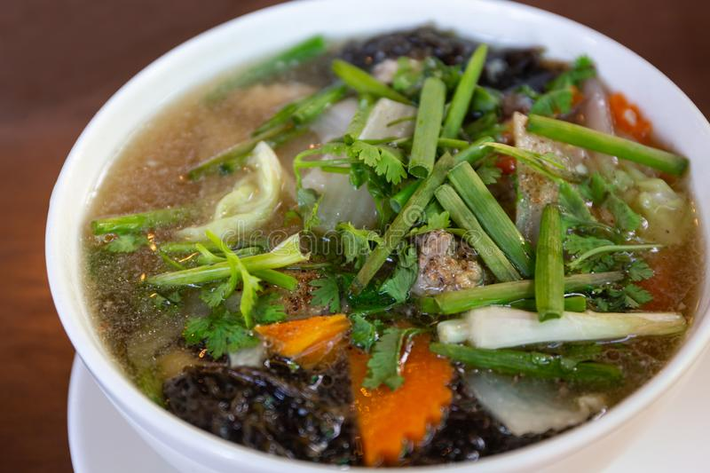 Clear soup with seaweed and minced pork royalty free stock images