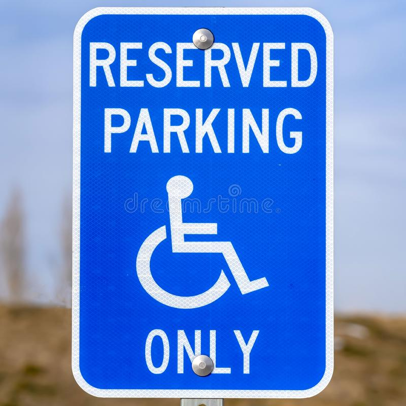 Clear Square Blue Reserved Parking Van Accessible sign with a man on a wheelchair icon stock photo