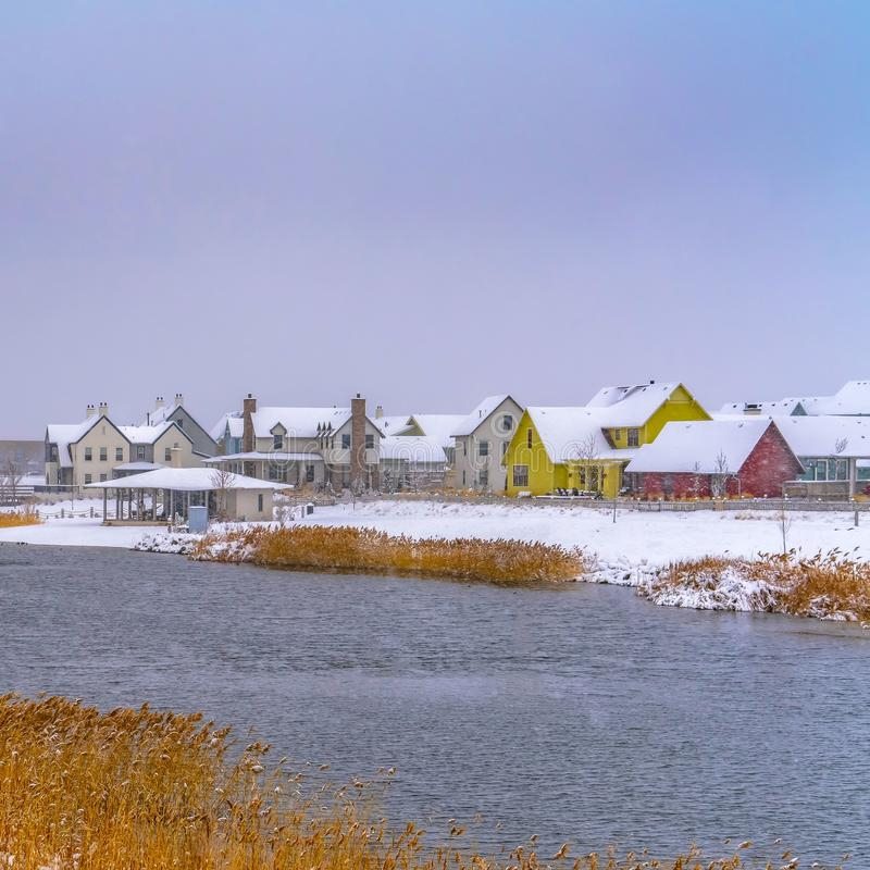 Clear Square Daybreak homes around Oquirrh Lake seen in winter royalty free stock image
