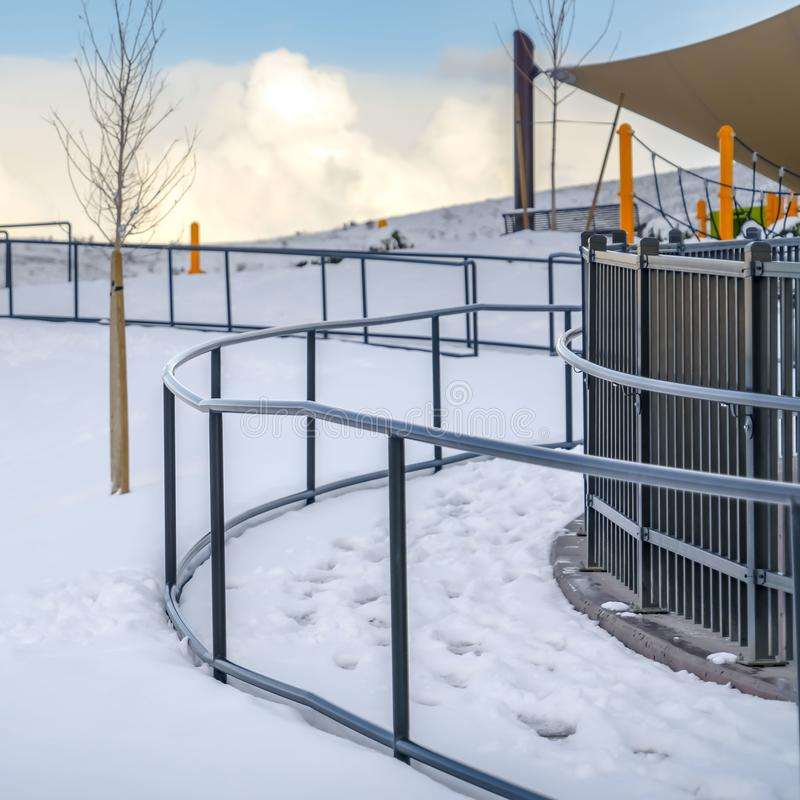 Clear Square Park in Eagle Mountain Utah against blue sky with clouds in winter royalty free stock image