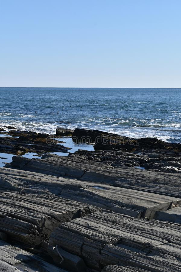Cape Elizabeth`s rocky shoreline on Cape Elizabeth, Cumberland County, Maine, New England Lighthouse, US. A clear sunny cold winter day along the rocky shoreline stock images