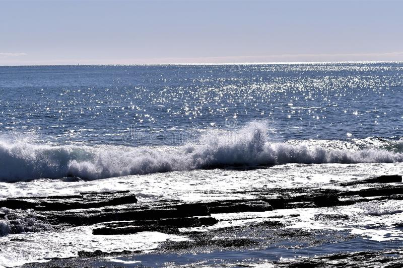 Cape Elizabeth`s rocky shoreline on Cape Elizabeth, Cumberland County, Maine, New England, US. A clear sunny cold winter day along the rocky shoreline at Dyer stock photography
